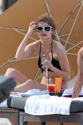 http://img103.imagevenue.com/loc1053/th_312845158_Mischa_Barton_Bikini_Candids_on_the_Beach_in_Miami_December_27_2011_261_122_1053lo.jpg